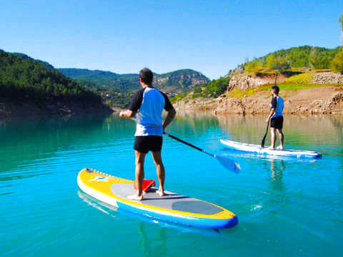 Paddle Surf Between Mountains and Sandy Castle