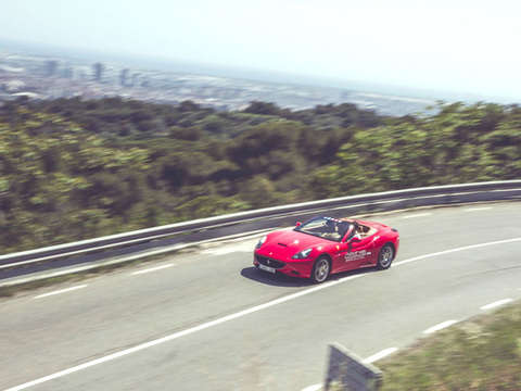 Drive a Ferrari from Barcelona to Montjuic